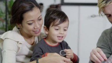 Attractive young multi ethnic family playing and learning together — Stock Video