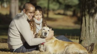 Couple with their loveable pet dog — Stock Video