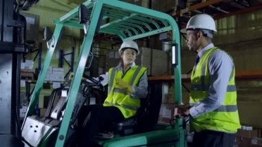 Male forklift truck driver arrives on shift — Stock Video