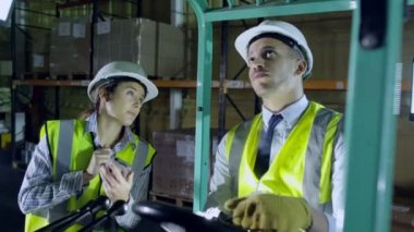 Forklift truck driver and co-worker are working — Stock Video
