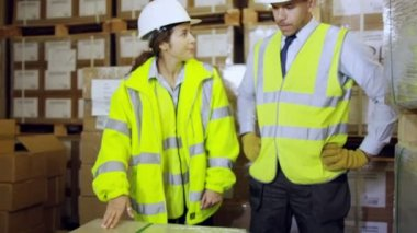 Two industrial workers discussing — Stock Video