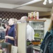 Shopkeeper takes a credit card payment from a cheerful female customer — Stock Video #45476615