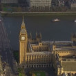Aerial view of the Houses of Parliament and the Westminster Bridge in London — Stock Video #45479069
