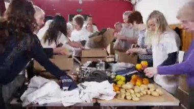 Charity volunteers and community members working together — Stock Video