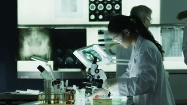 Researchers working together in laboratory — Stock Video