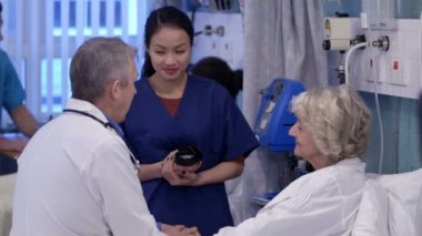 Medical staff taking care of patients — Stock Video