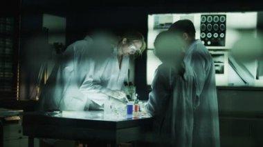 Scientists working in dark laboratory — Stock Video
