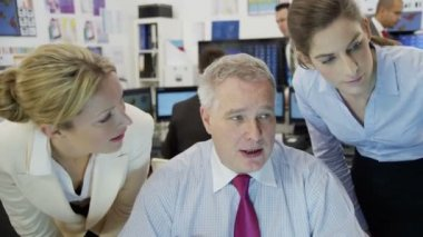 Diverse team of financial traders hard at work in a busy office — Stock Video