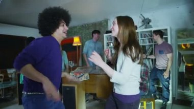 Happy and carefree group of young friends drinking and dancing at a house party — Stock Video