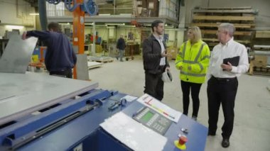 Warehouse or factory management team overseeing production — Stock Video
