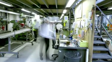 Busy workers in the office section of a warehouse or factory — Stock Video