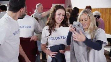 Charity volunteers sorting through donated goods — Stock Video