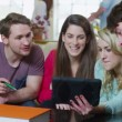 Happy group of students working together in their shared accommodation — Stock Video