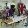 Diverse group of young students working together on a project — Wideo stockowe #45487661
