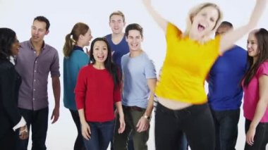 Multi ethnic group of people standing together in brightly colored casual clothing and having fun — Stockvideo