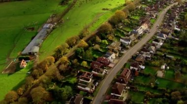 Aerial view over houses in the English countryside — 图库视频影像