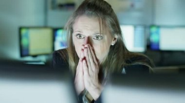 Businesswoman working late is upset by something she sees on her computer — Stock Video