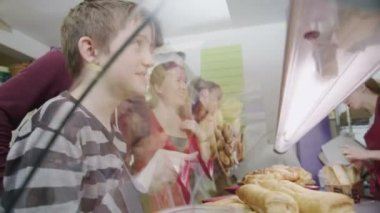 Cute and happy little boy choosing a fresh savory pastry at the bakery counter — Stock Video