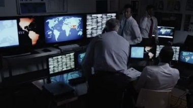 Male security personnel in system control room — Stock Video