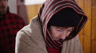 Homeless and needy people, wrapped up warm against the cold are standing in line — Stock Video