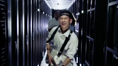 IT engineers rocking out in a data center — Stock Video