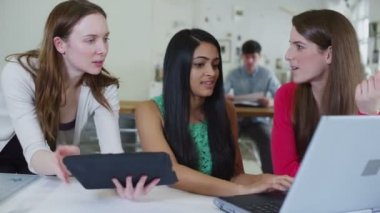 Young female students working together with technology — Stock Video