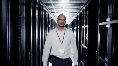 Portrait of a smiling IT engineer working in a data centre — Stock Video