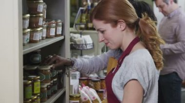 Customers and staff members in a small friendly delicatessen or food store — Stock Video