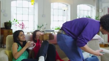 Happy diverse group of young friends hanging out at home and laughing together — Stock Video