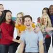 Multi ethnic group of people standing together in brightly colored casual clothing and having fun — Stock Video #45500617
