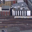 Passenger trains passing at station — Stock Video