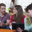 Happy group of students studying together in their shared accommodation — Stock Video