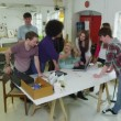 Diverse group of young students working together on a project — Wideo stockowe #45503753