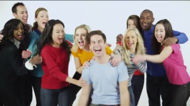 Multi ethnic group of people standing together in brightly colored casual clothing and having fun — Stock Video