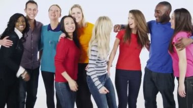 Multi ethnic group of people standing together in brightly colored casual clothing and having fun — Vidéo
