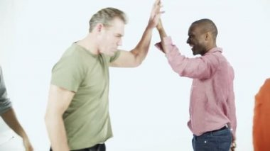 Multi ethnic people in colored clothing — Stock Video