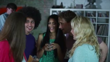 Happy and carefree group of young friends dancing and flirting at a house party — Stock Video
