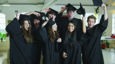Portrait of college or university students on graduation day — Stock Video