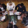 View from above of mixed ethnicity business team in a meeting — Stock Video #45615151