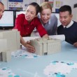 Happy and attractive mixed ethnicity team of architects or engineers in a meeting — Stock Video #45615599