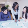 Global business team examining a map of the world — Stock Video