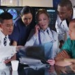 Group of colleagues in a medical meeting discuss a patient's x ray results — Stok video #45617807