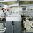 Team of professional chefs preparing food in commercial kitchen — Stock Video #45618409