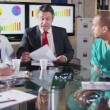 Diverse group of medical professionals in a meeting with a hospital executive — Stock Video