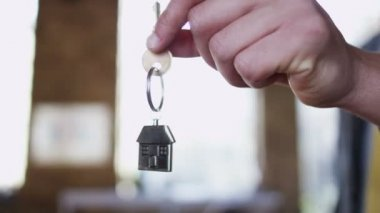 Key symbolising purchase of new home — Stock Video
