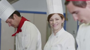 Portrait of a happy female chef in a commercial kitchen — Stock Video