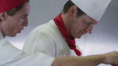 Chefs preparing food in commercial kitchen — Stock Video