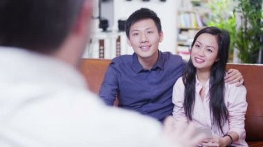 Attractive young couple in discussion with their financial advisor — Stock Video