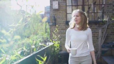 Woman enjoying moment in garden — Stock Video
