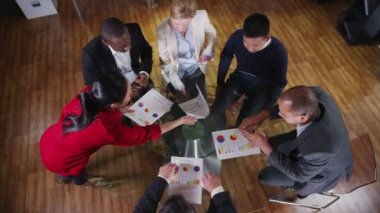 View from above of mixed ethnicity business team in a meeting — Stock Video